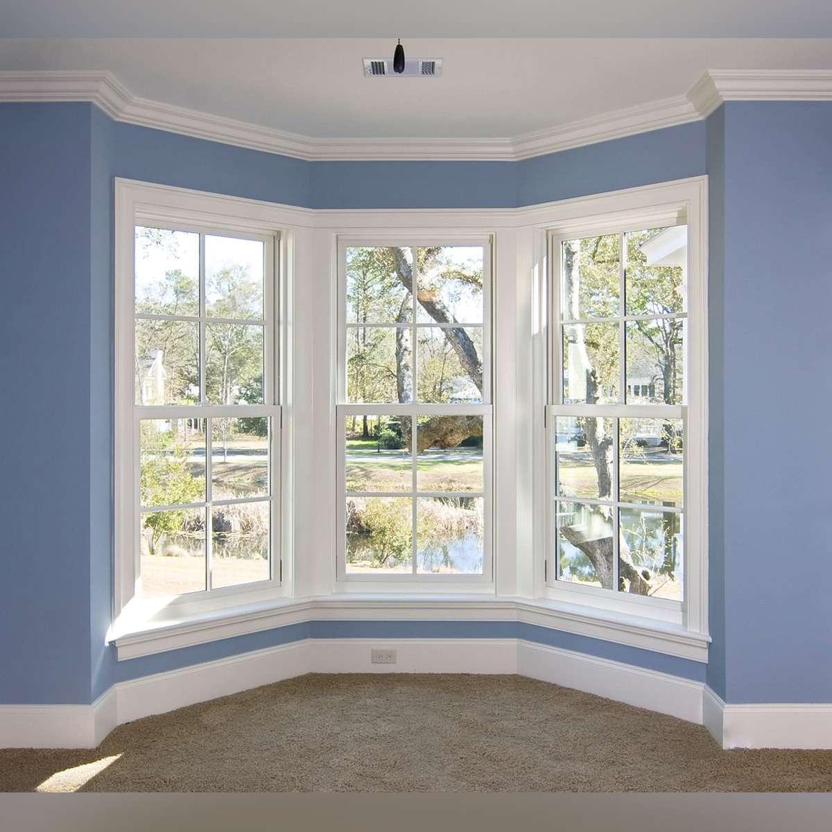 White bay window on a blue wall