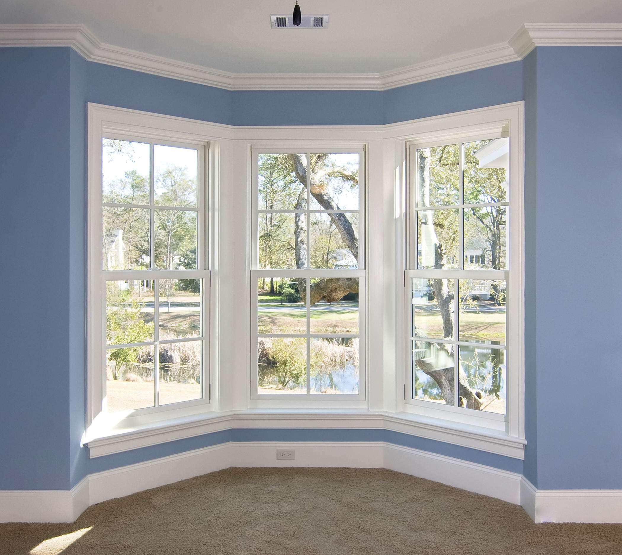 White bay window on a blue wall