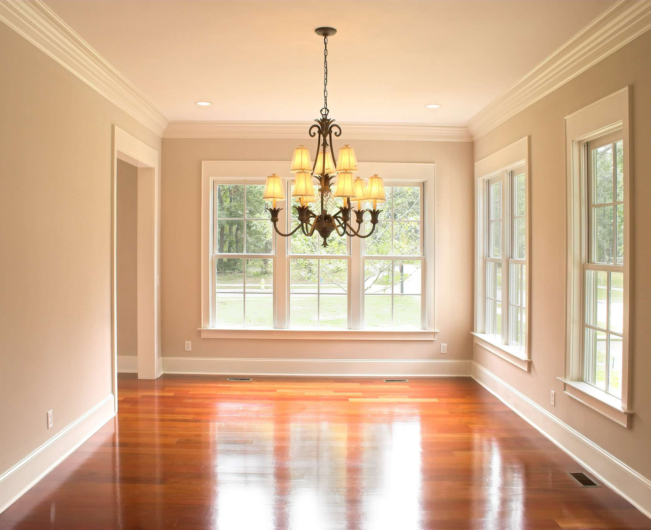 Bright hallway with a chandelier and white hung windows