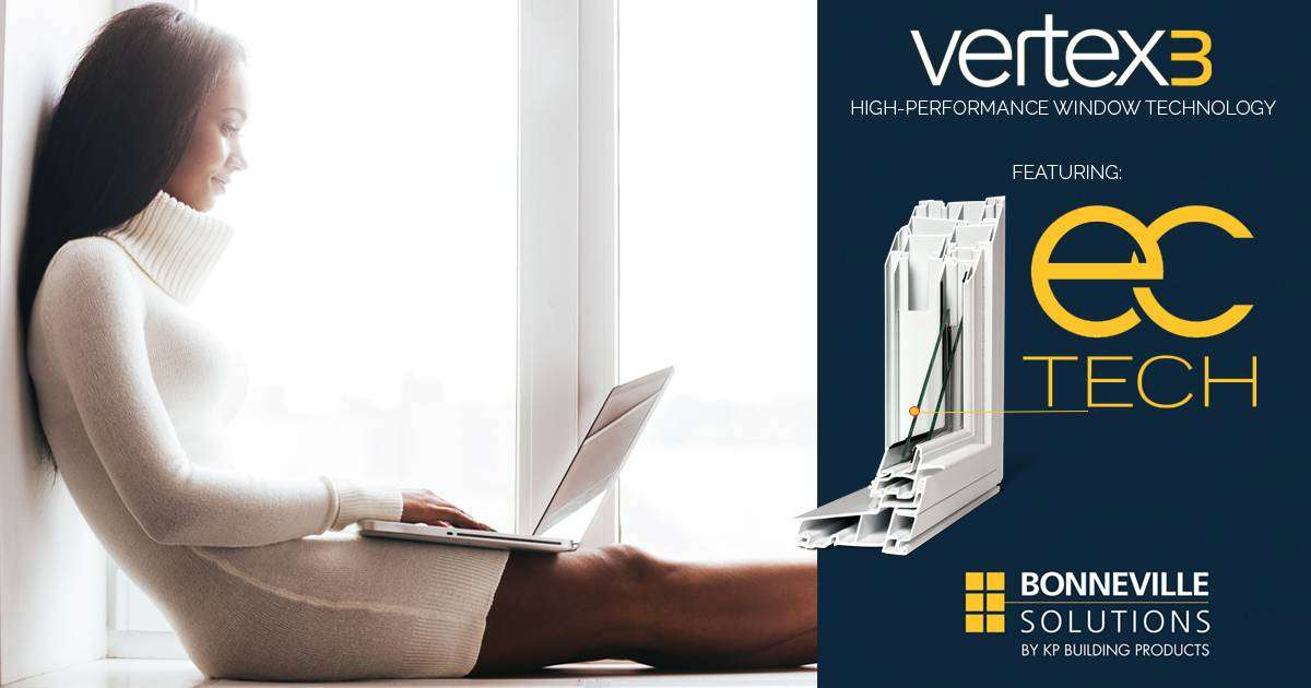 A woman wearing a white dress sitting on a window ledge, typing on her lap top. Vertex 3 ad on the right side of the image.